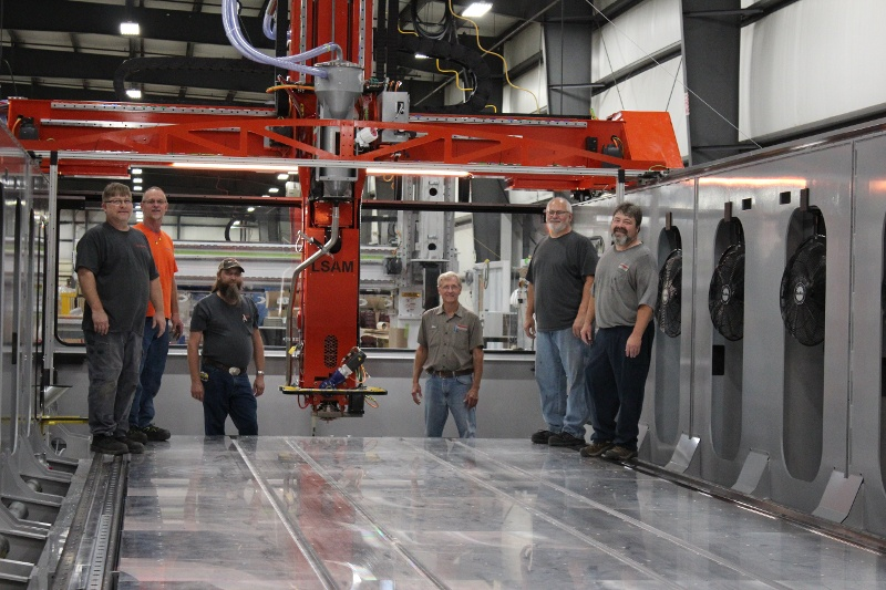 Some of the guys who helped build this latest LSAM pose with the machine.