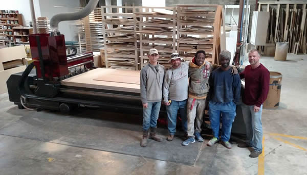 Larry Crutchfield and the guys of Alpha Woodworks with their Thermwood Cut Center