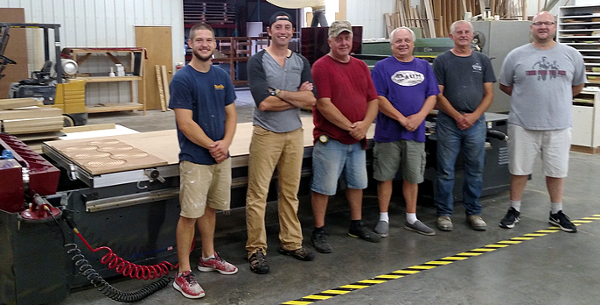 Matt Schiller of AUM Wood Products with his employees and their new Thermwood Cut Ready Cut Center