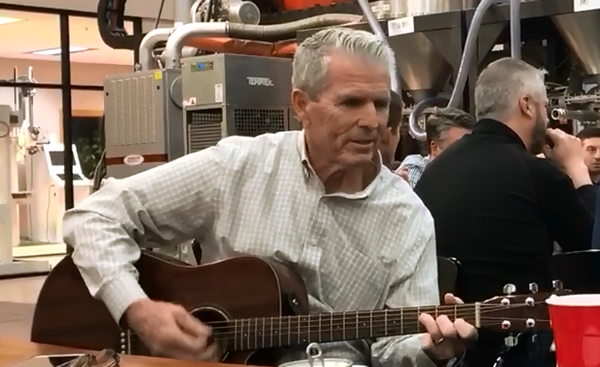 Thermwood Dealer Dave White playing guitar at the 2019 Thermwood Dealer Conference Awards Dinner