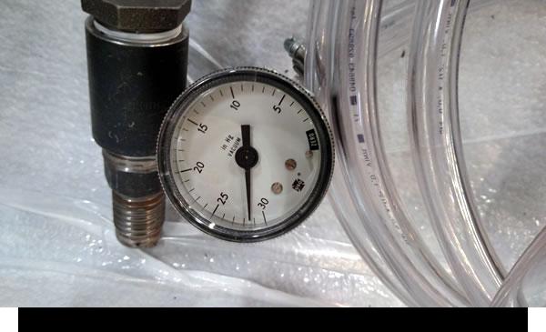 LSAM tool vacuum test - holding vacuum with vacuum line removed - Closeup