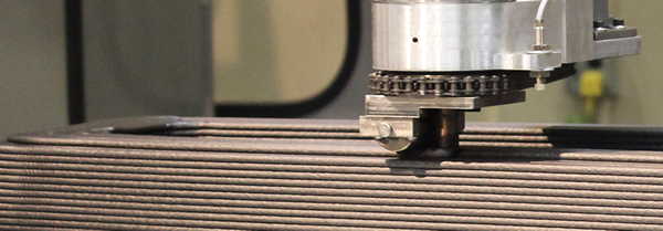 With LSAM - first, the part is 3D printed, layer by layer