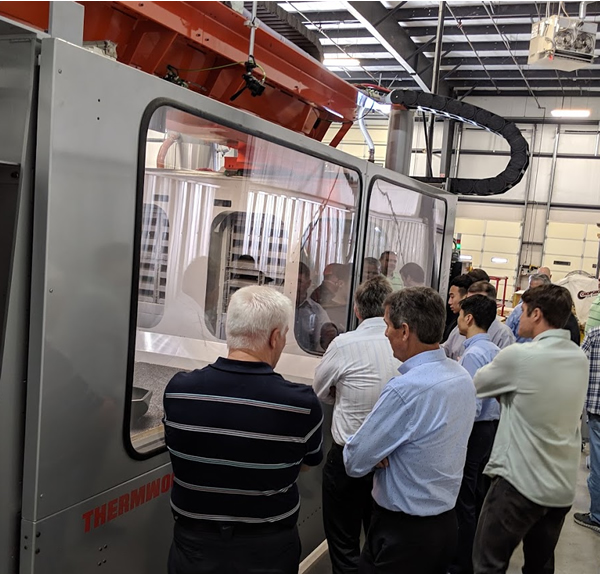 Thermwood personnel, domestic and international dealers attend an LSAM demonstration on our trainer machine during the 2019 Dealer Conference.
