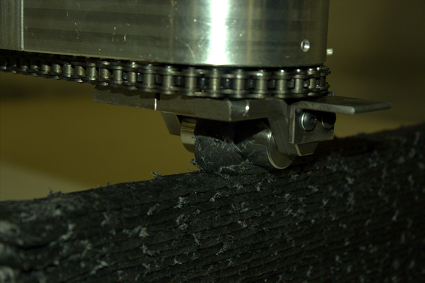 Thermwood's MeltShape wheel is servo controlled to precisely follow machine motion.