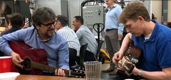 Turkish Dealer Mengu Arslanoglu and Thermwood's Duane Marrett playing guitar at the 2019 Thermwood Dealer Conference Awards Dinner