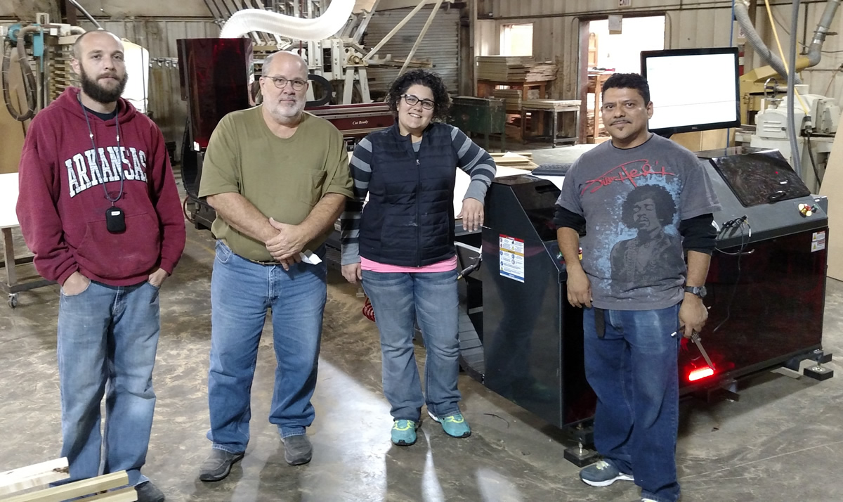 Cody, John, Christina and Alberto of Arkansas Wood Doors with their new Thermwood CutReady Cut Center at their shop.