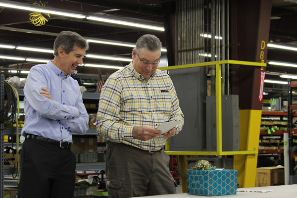 David and Rich reading a card signed by all employees at Thermwood.